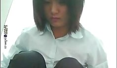Beautiful Chinese teen dildoing in a public place
