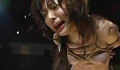 Tied Asian in Sleepwalker style bondage More