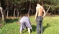 Mature redhead older woman is having outdoor sex