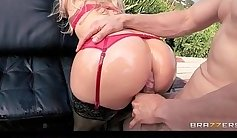 Alluring blonde goddess shows her oiled booty and tits