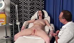 Nurse curves and plays with her pierced vagina