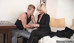 Blonde maid sucks off her horny fellow in the kitchen